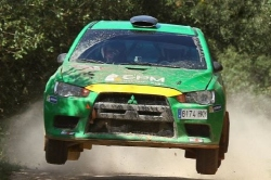 EPM's Mitsubishi flies above Vidreres gravel.