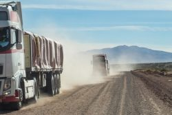 HD Trucks on dusty Bolivian road