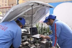 Gastec technicians tuning vehicle through utilizing laptop 2018